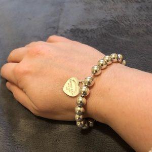 Tiffany &Co Brand New silver heart charm bracelet